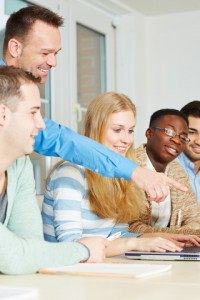 http://www.dreamstime.com/royalty-free-stock-photos-teacher-his-students-school-class-pointing-to-laptop-computer-image29830798